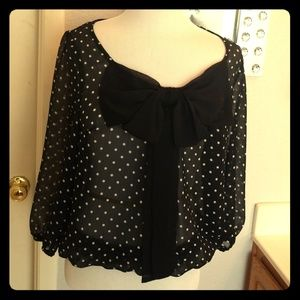 Sheer polka dot blouse.